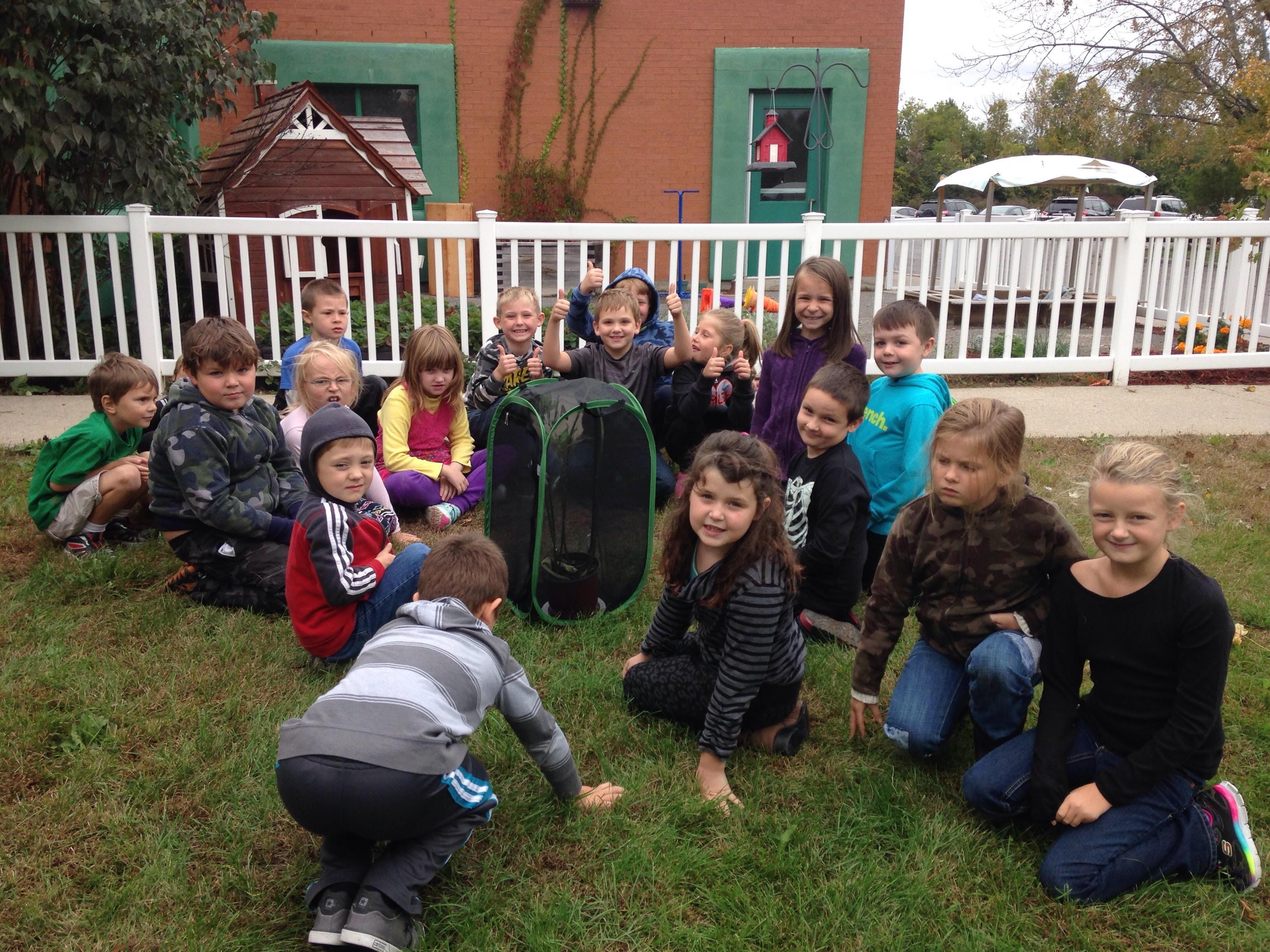 J.J. O'Neill school kids with aviary